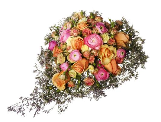 Låg blombukett med rosor, ranunkler och nejlikor.