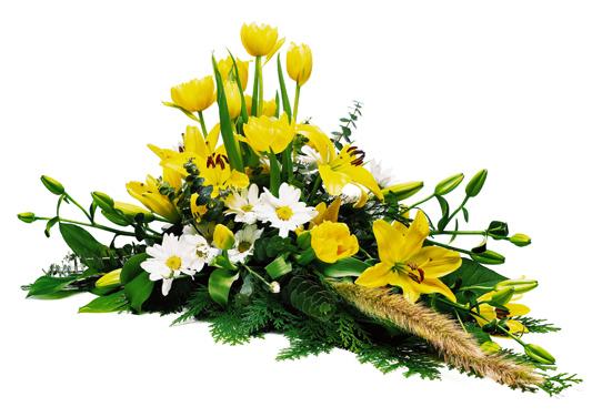 Låg blomdekoration med tulpaner, liljor och krysantemum.