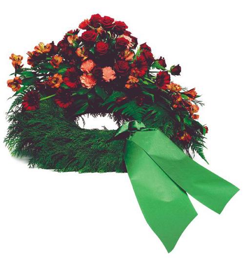 Grön blomkrans med blommor i rött och orange.