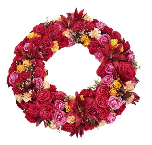 Blomkrans med röda, rosa och gula blommor.